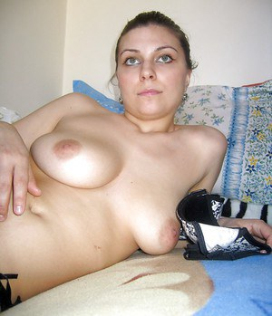 Lusty amateur with massive melons stripping and spreading her legs