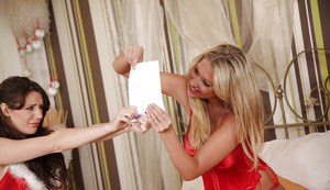 Sexy lesbians Samantha Bentley & Lexi Lowe have some fun in the bedroom