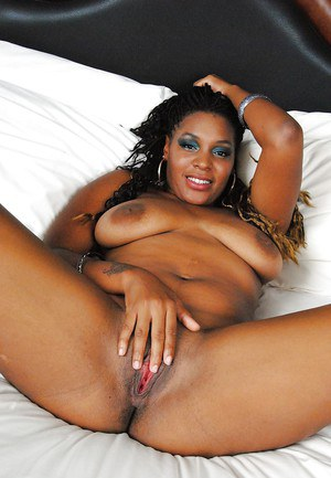 Chubby ebony babe Cassie Love stripping and spreading her legs