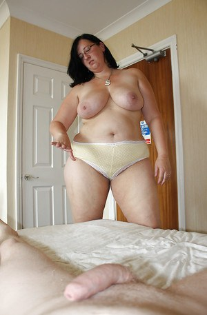 Fatty mature brunette in glasses stripping and jerking off a big cock