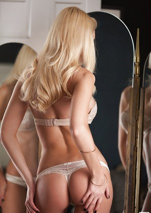 Graceful blonde hottie Shera Bechard slipping off her lingerie top