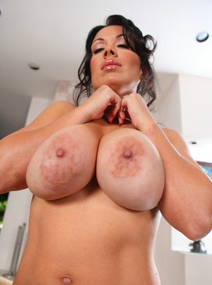 Latina MILF with massive boobs Sienna West slipping off her clothes