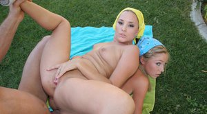 Naughty teenage sluts with shaved cunts enjoy FFM groupsex outdoor