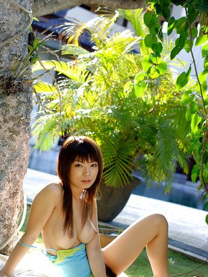 Asian coed Hikari Hino revealing her perfect bosoms and hairy pussy outdoor