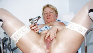 Fatty mature lady pumping her flabby tits and toying her twat
