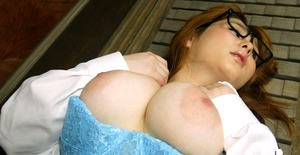Asian amateur Yamazaki Akari revealing her massive melons and hairy pussy