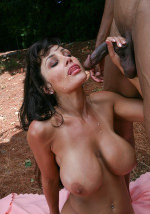 Ravishing mature vixen Lisa Ann gets screwed by a black guy outdoor