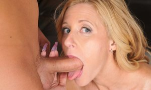 Holly Claus gives a blowjob and gets her pierced twat cocked up