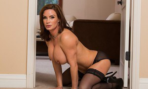 Sexy MILF in stockings Diamond Foxxx gets rid of her dress and lingerie