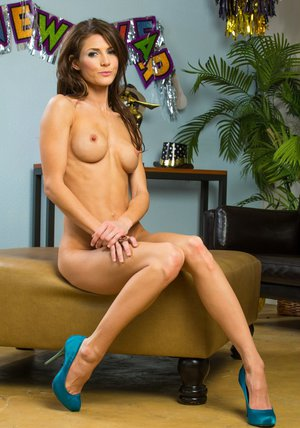Graceful MILF Jenni Lee stripping and spreading her slender legs