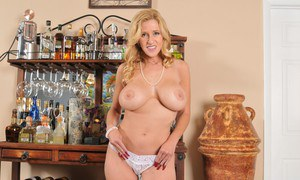 Mature lady Holly Claus taking off her clothes and exposing her pierced twat
