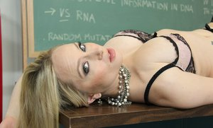 Seductive teacher in glasses Aiden Starr stripping in the classroom