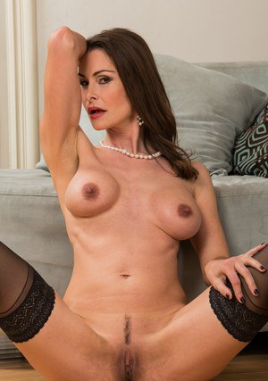Mature vixen Nora Noir slipping off her dress and erotic lingerie