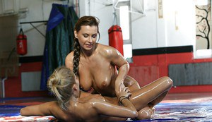 Fascinating lesbians in black bikinis enjoy an oily catfight