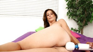 Bosomy mature lady Mimi Moore stripping and playing with a magic vibrator