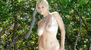 Sexy MILF Charlee Chase stripping and playing with a vibrator outdoor
