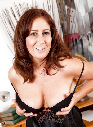 Lusty mature lady Carol Foxwell gets rid of her clothes and teases her cunt