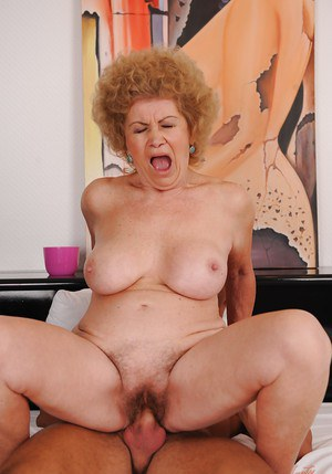 Big busted granny with hairy twat sucks and fucks a young cock