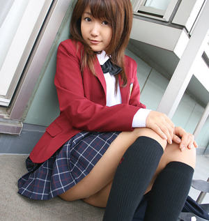 Lusty asian coed in uniform flashing her panties and tiny tits