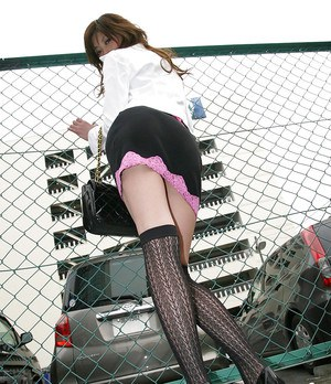 Attractive asian lady in stockings gets rid of her clothes