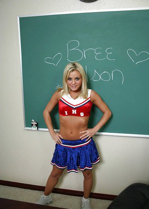 Nasty cheerleader Bree Olson revealing her big tits and shaved cunt
