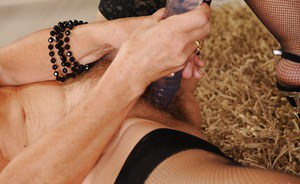 Lascivious granny stuffing her hairy twat with a huge dildo