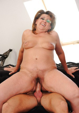 Chubby granny in glasses has a hardcore sex with a younger guy