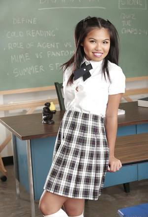 Sweet asian schoolgirl Cindy Starfall stripping in the classroom
