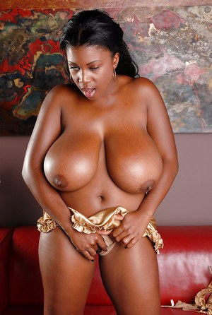 Curvaceous ebony babe reveals her huge melons and gives a handjob
