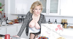 Mature fetish lady with big tits has no panties under her jeans