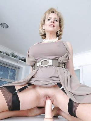 Horny fetish lady lifting up her dress and toying her shaved twat