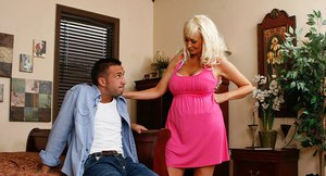 Brittany Oneil gives a sensual blowjob and takes a cumshot on her big jugs
