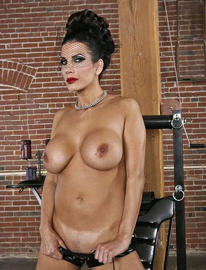 Kinky MILF in latex outfit Shay Sights gives a blowjob and gets shagged