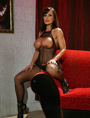Vampish pornstar in pantyhose suit Lisa Ann has some fun with a big cock