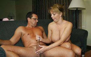 Sultry mature lady with big boobies strips and gives a great handjob