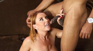 Lusty MILF Janet Mason fucks a big black dong and gets facialized