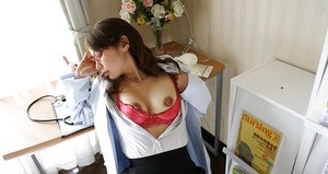 Naughty asian doctor in glasses revealing her nice tits with hard nipples