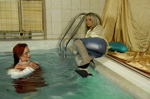 Fully clothed MILFs Gina Killmer & Kety Pearl have some fun in the pool