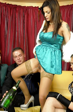 Kinky european fashionistas have some fully clothed pissing fun