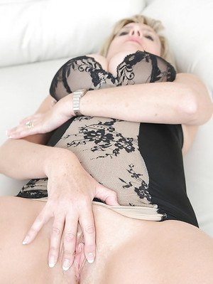 Naughty fetish lady in lingerie revealing her tits and fingering her cunt