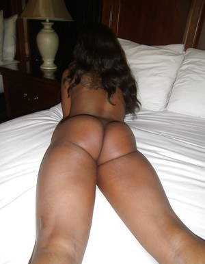 Bootylicious ebony babe Millian Blaze stripping and posing on the bed