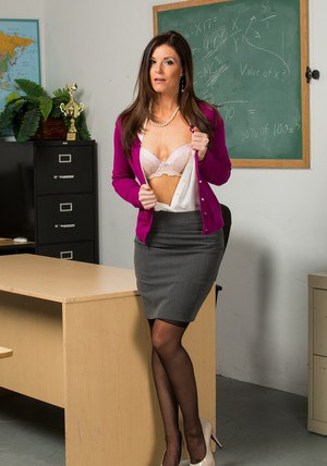 Seductive teacher India Summer stripping off her suit and lingerie