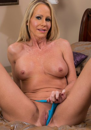 Mature vixen Simone Sonay taking off her lingerie and spreading her legs