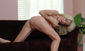 Naughty mature blonde Mrs. Vette stripping and rubbing her clit