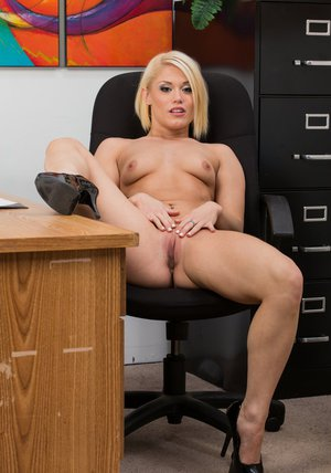 Voluptuous office blonde Ash Hollywood uncovering her sexy body