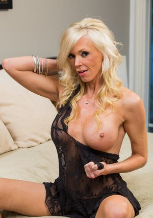 Mature blonde with big round tits Demi Dantric slipping off her lingerie