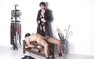 Naughty femdom torturing her male pet's cock and face sitting him