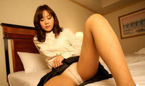 Asian coed takes off her pantyhose and teases her cunt through her panties