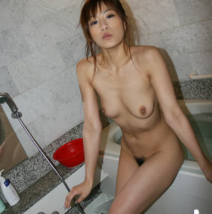 Pretty asian chick taking shower and teasing her hairy slit