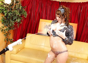 Fetish lady Scarlet Richie has some messy fun with dildos and fake jizz
